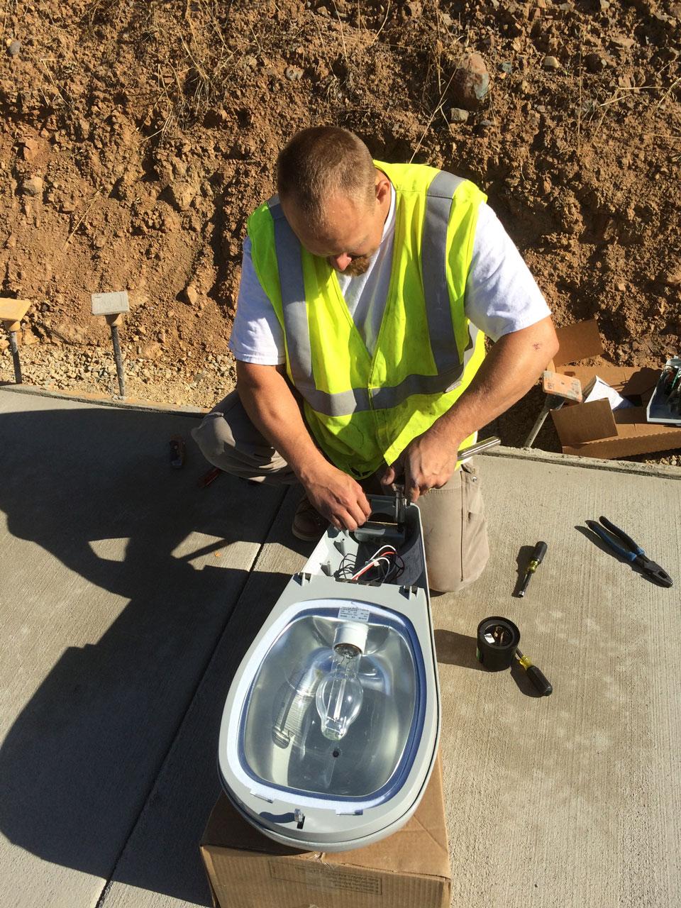 Bullert Team Member Fixing a Device