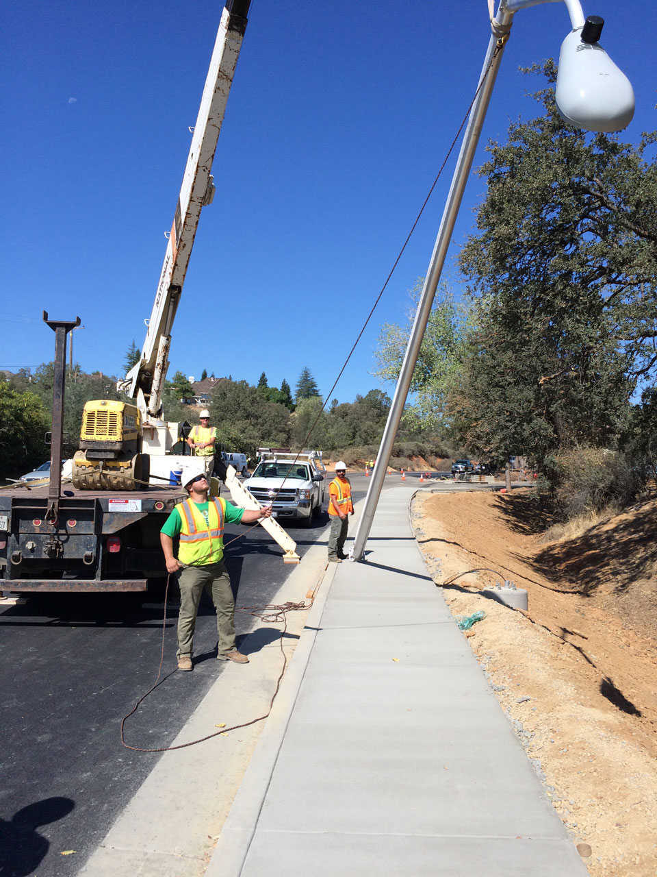 Bullert Team Doing Electrical Construction on a Road