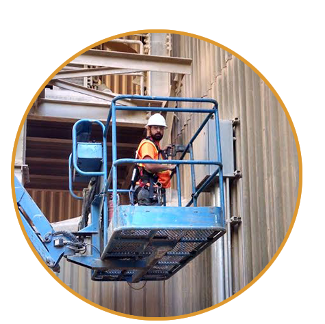 Bullert Team Member in a Lift by the Side of an Industrial Building