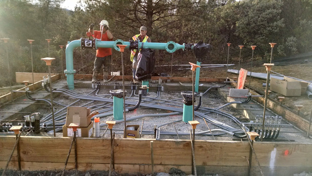Bullert Team Members Installing Electrical System for South Weed Well